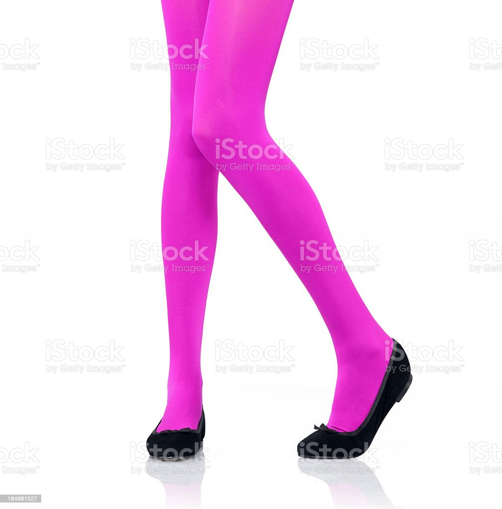 Woman's legs modeling bright pink tights royalty-free stock photo
