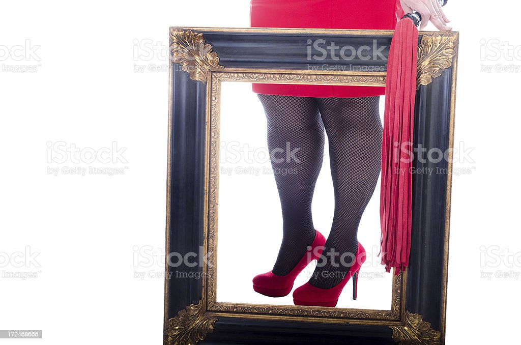 Woman's legs through ornate picture frame. stock photo