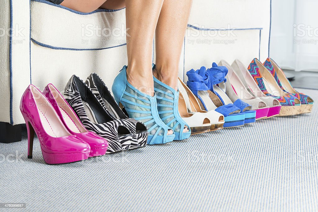 Woman?s legs with various High Heels shoes stock photo