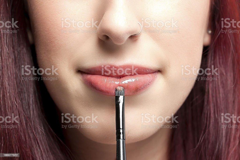 Woman's Lipstick application stock photo