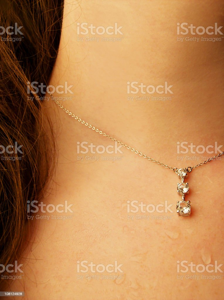 Woman's Neck Wearing Necklace with Beads of Sweat royalty-free stock photo