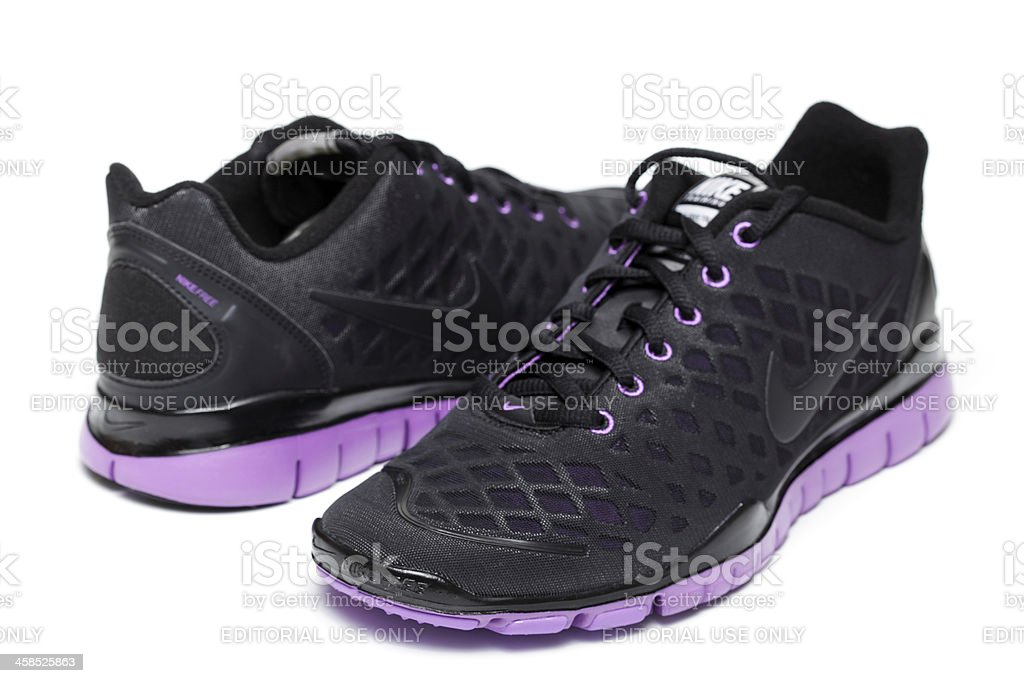Womans Nike Free TR Fit shoes on white royalty-free stock photo