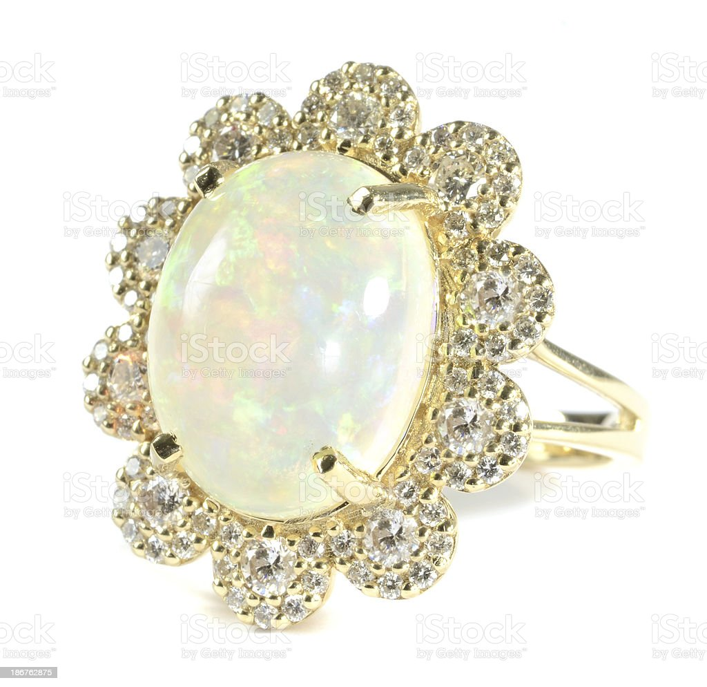 Woman's Opal, Diamond and Yellow Gold Ring royalty-free stock photo
