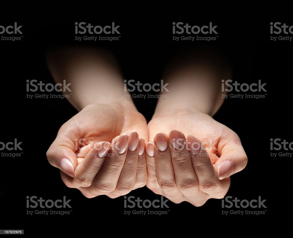 Woman's Open Hands in Dramatic Light royalty-free stock photo