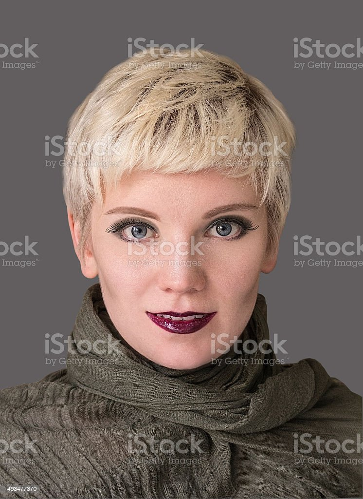 Woman`s portrait blonde. Fashion hairstyle, haircut, makeup in grey shades. stock photo