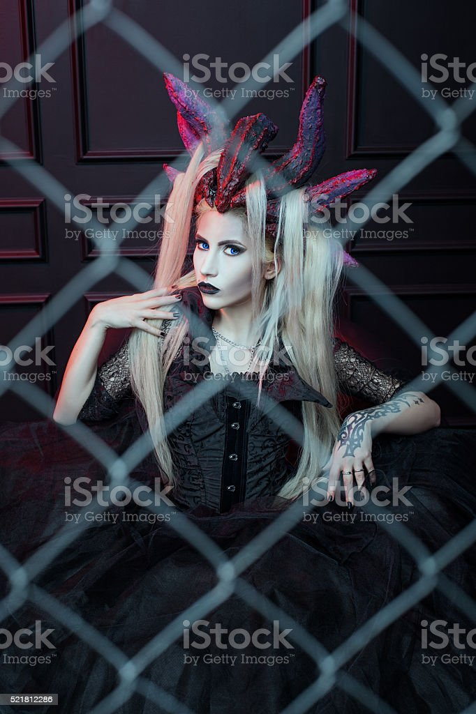 Woman's portrait with horns. stock photo