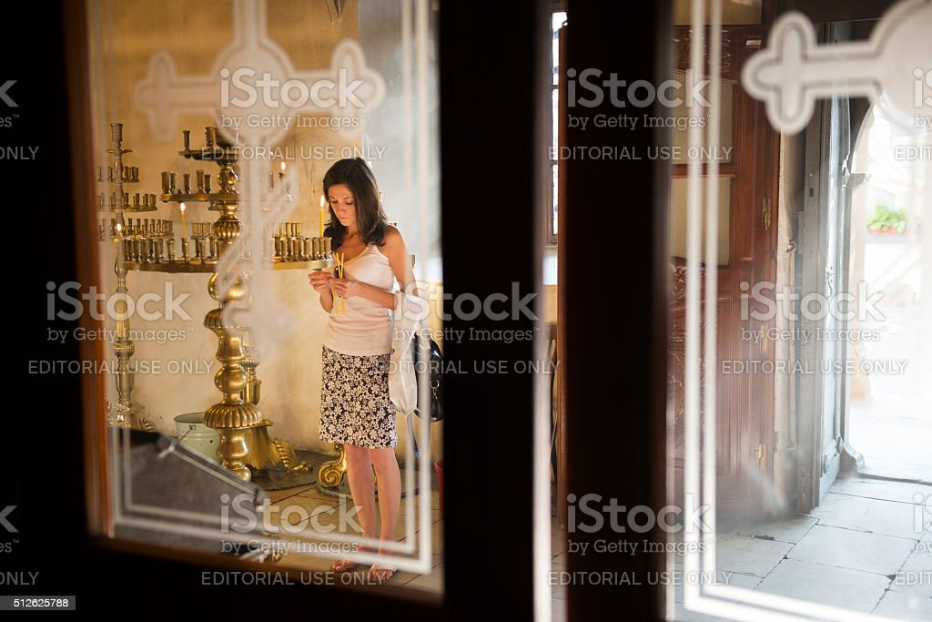 Woman's prayer at St. Marina Church (Plovdiv, Bulgaria) stock photo