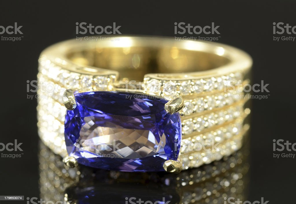 Woman's Sapphire, Diamond and White Gold Wedding Ring royalty-free stock photo
