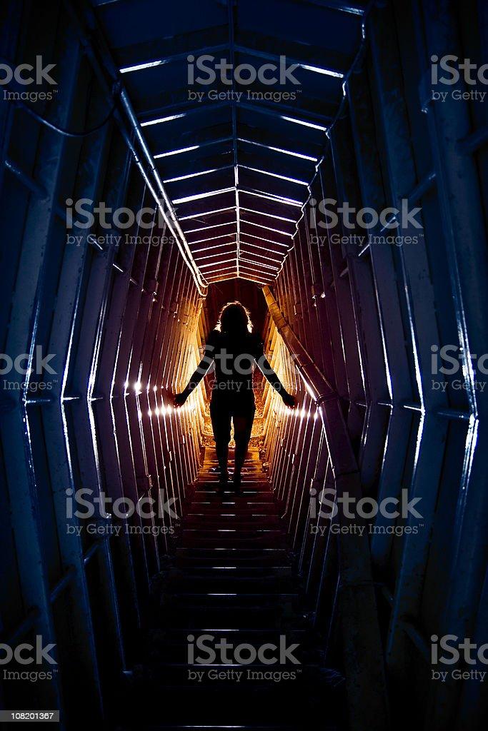 Woman's Silhouette in Futuristic Time Travel Tunnel stock photo
