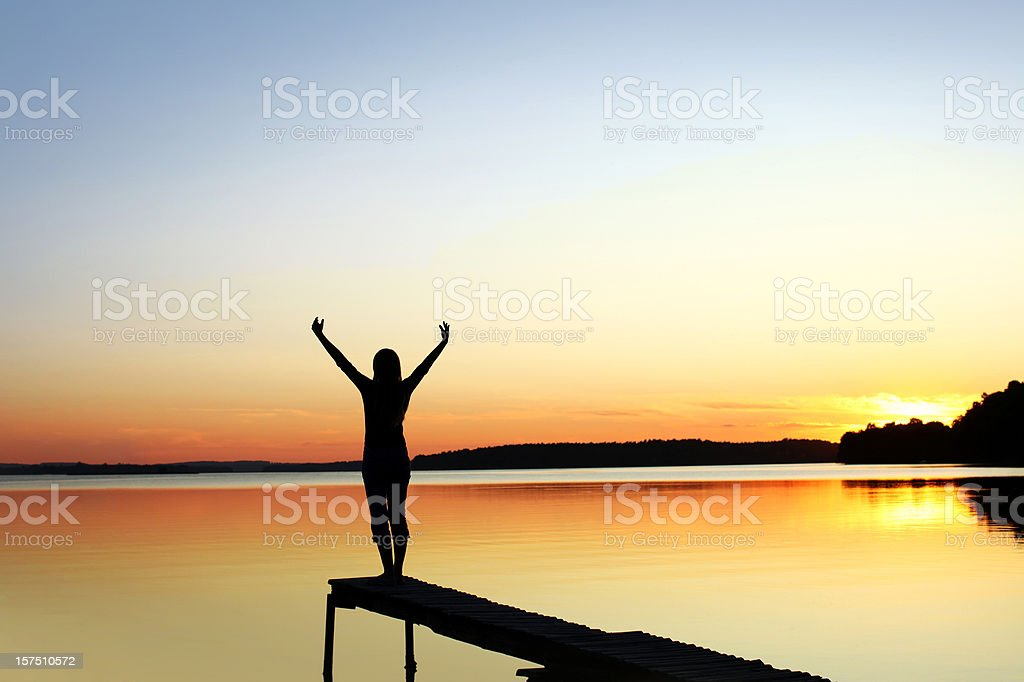 Woman's Silhouette on a Beautiful Nature Scene stock photo