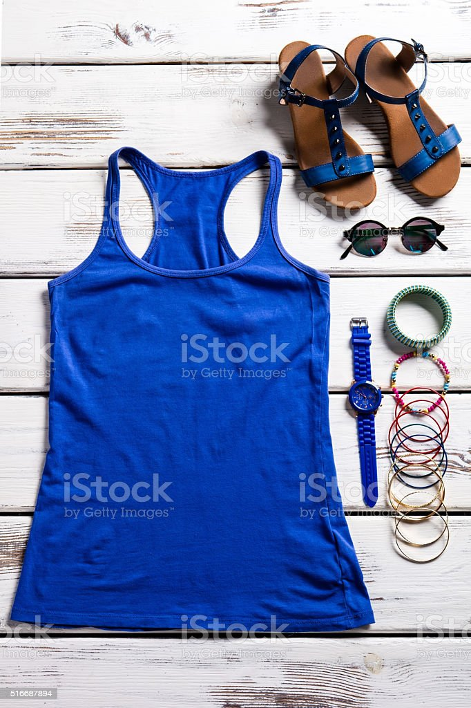 Woman's top and summer footwear. stock photo