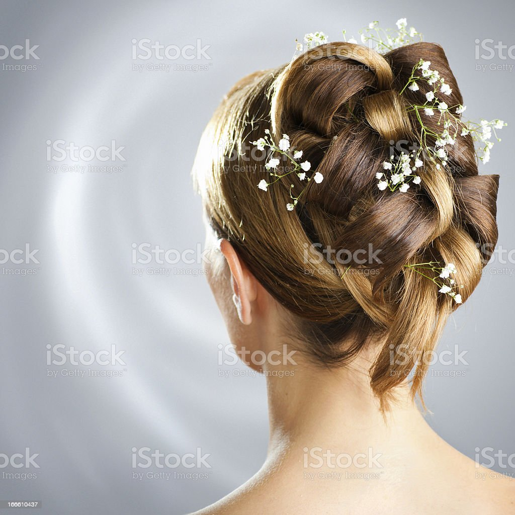 A woman's wedding hair style with braids and baby's breath stock photo