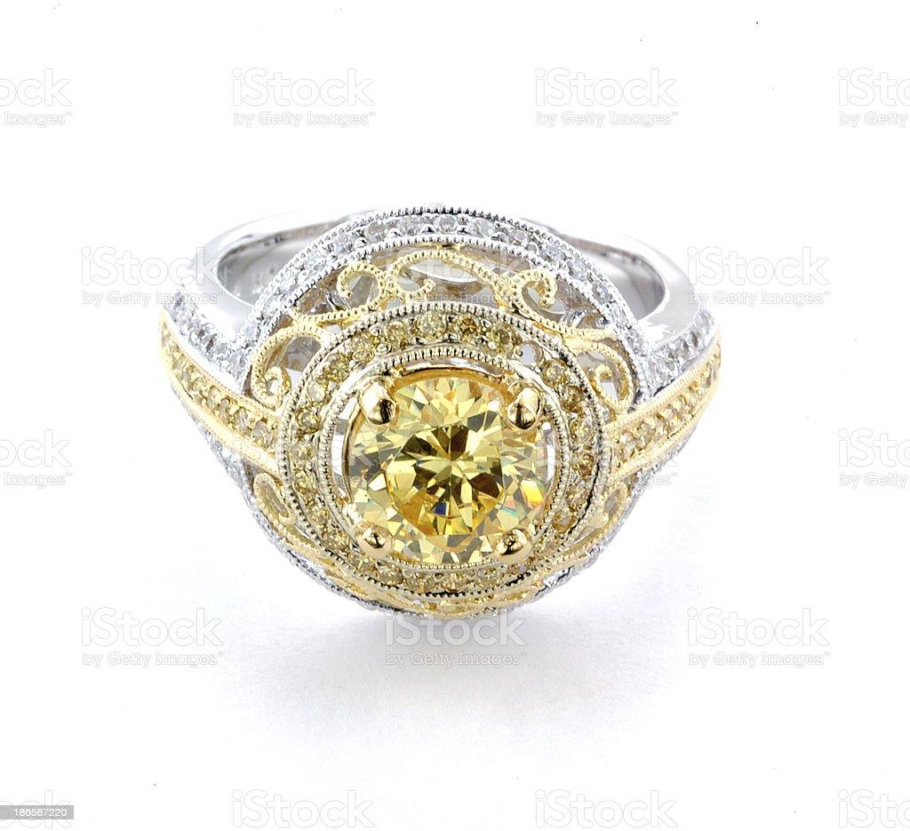 Woman's Yellow Diamond and Gold Wedding Ring royalty-free stock photo