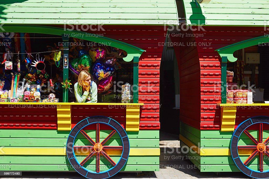 Woman-seller in park at counter food and drink stock photo