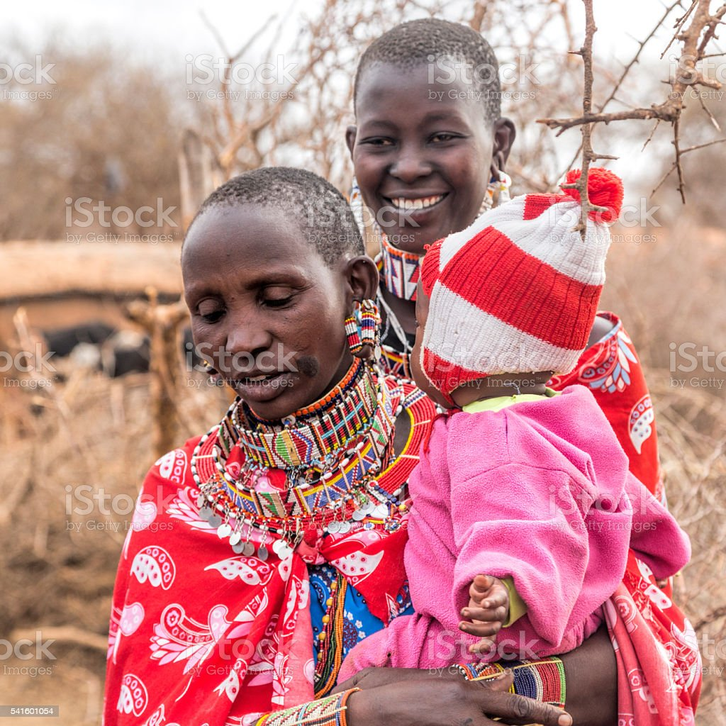 Women and children in Maasai village. Kenya stock photo