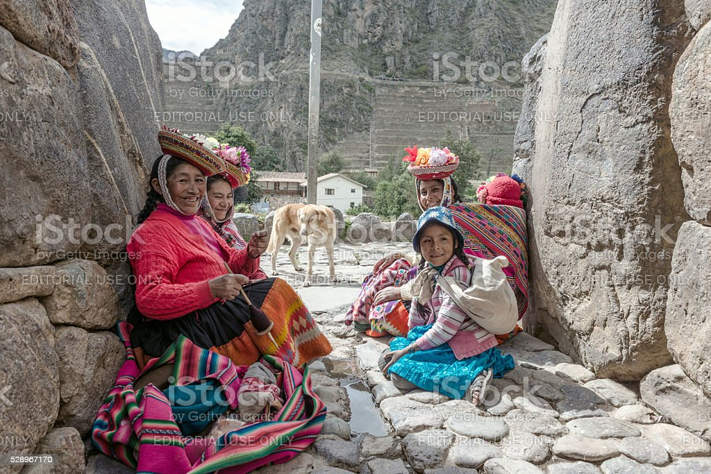 Women and children in traditional Peruvian clothes stock photo
