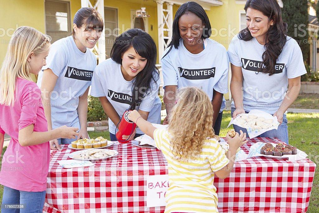 Women And Children Running Charity Bake Sale stock photo