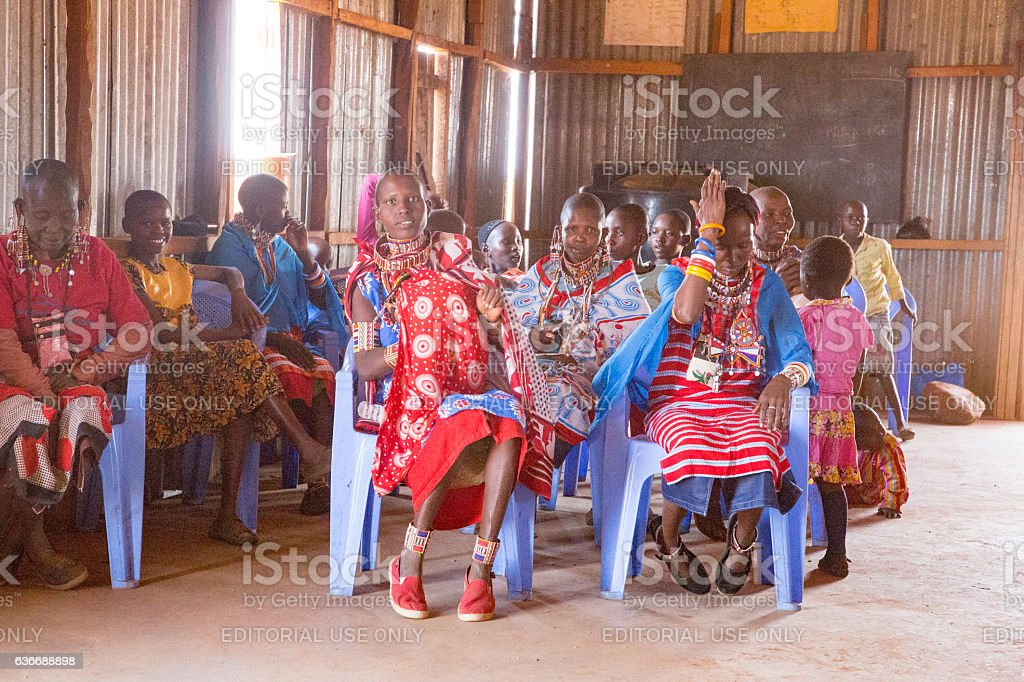 Women and children sitting in Masai church stock photo