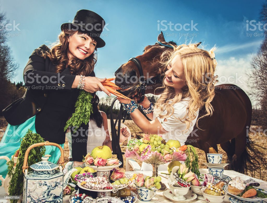 Women and horse royalty-free stock photo