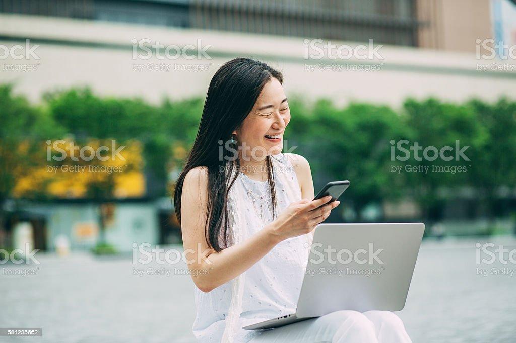 Women and technology stock photo