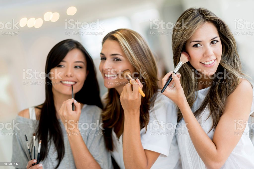 Women applying make up stock photo