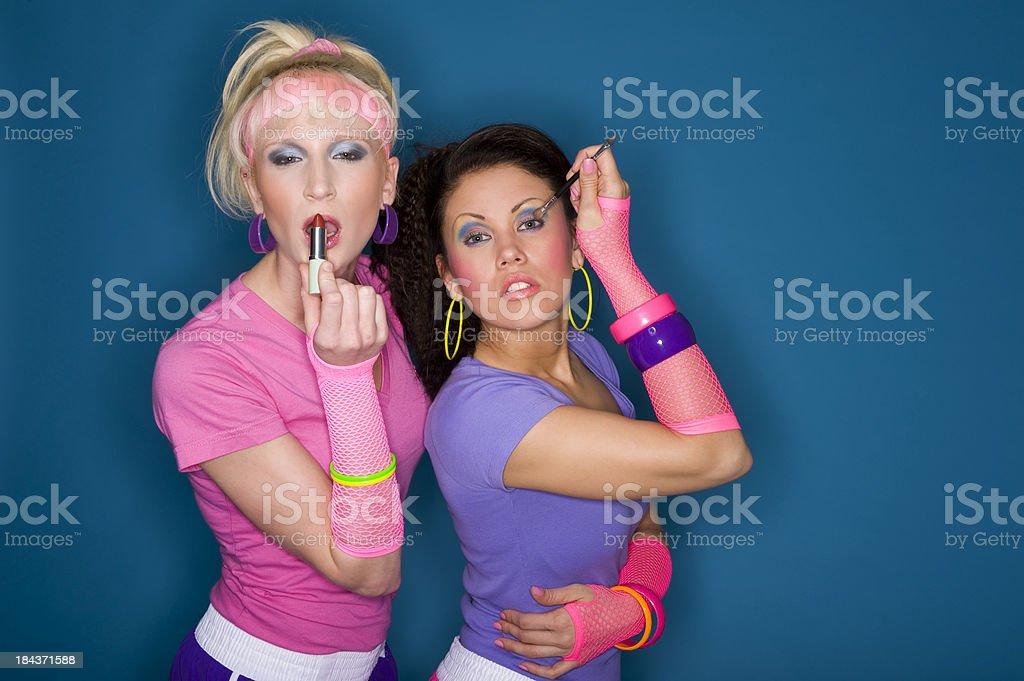 Women Applying Makeup royalty-free stock photo