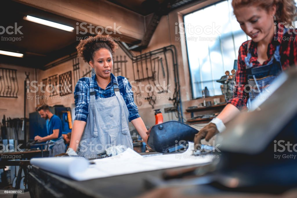 Women are capable of welding too stock photo