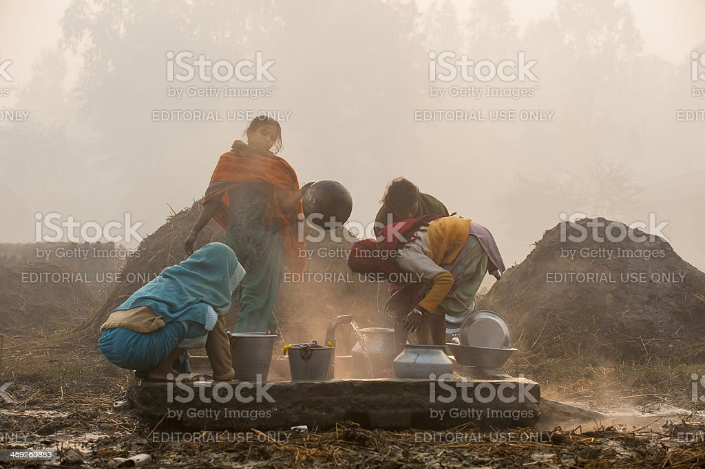 Women are fetching water in village close to Janakpur, Nepal stock photo