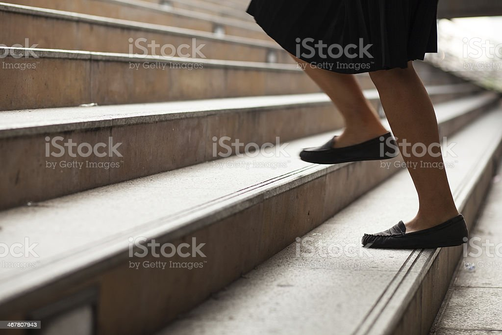 Women are moving up the ladder. stock photo