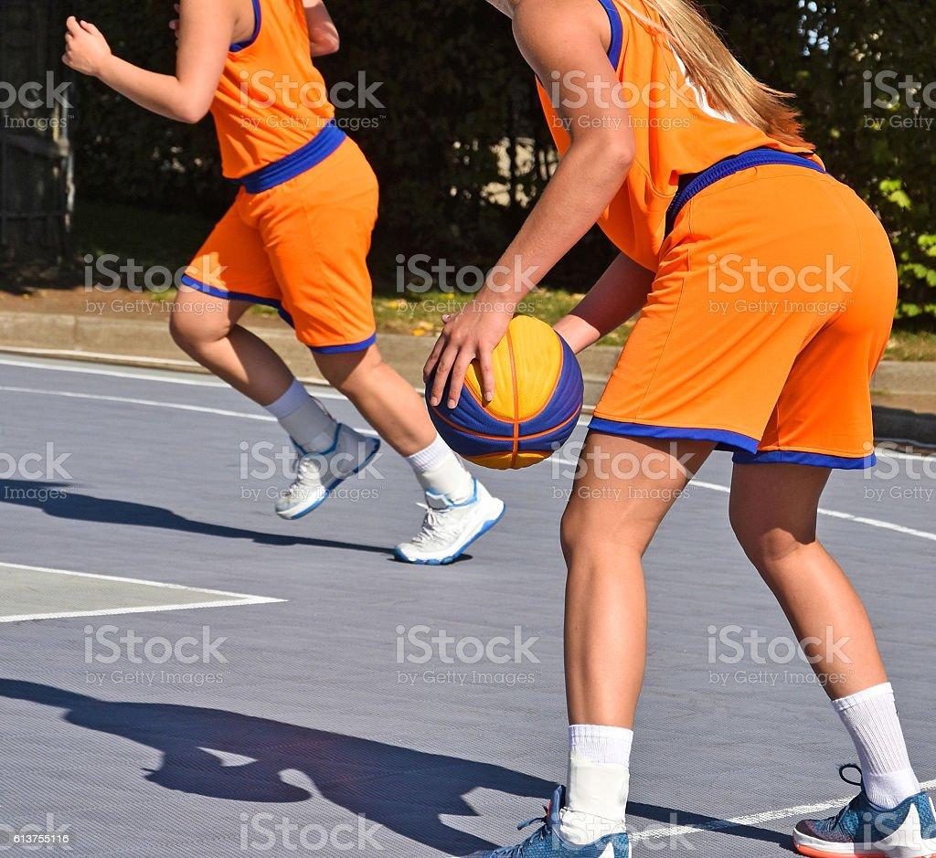 Women are playing basketball stock photo