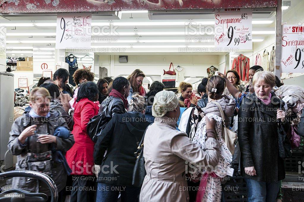 Women assaulting a cheap dress shop during sold season royalty-free stock photo