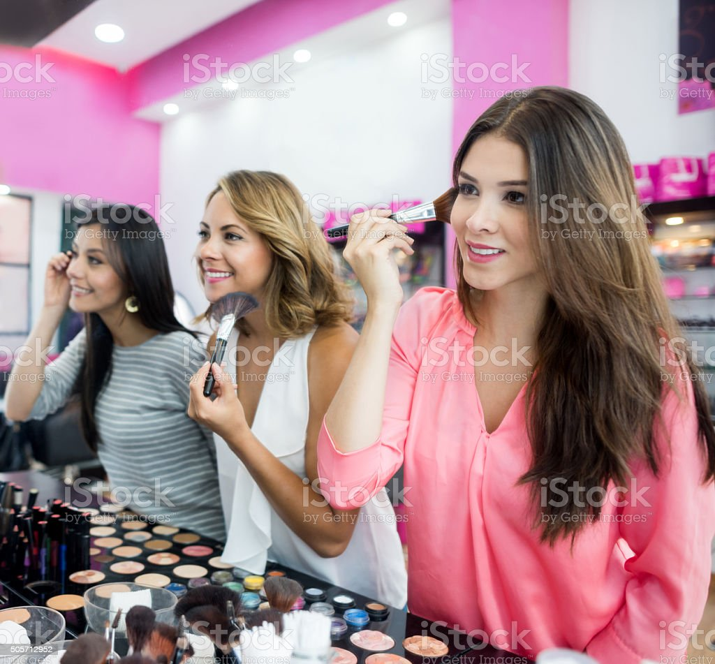 Women at a beauty store trying some makeup stock photo