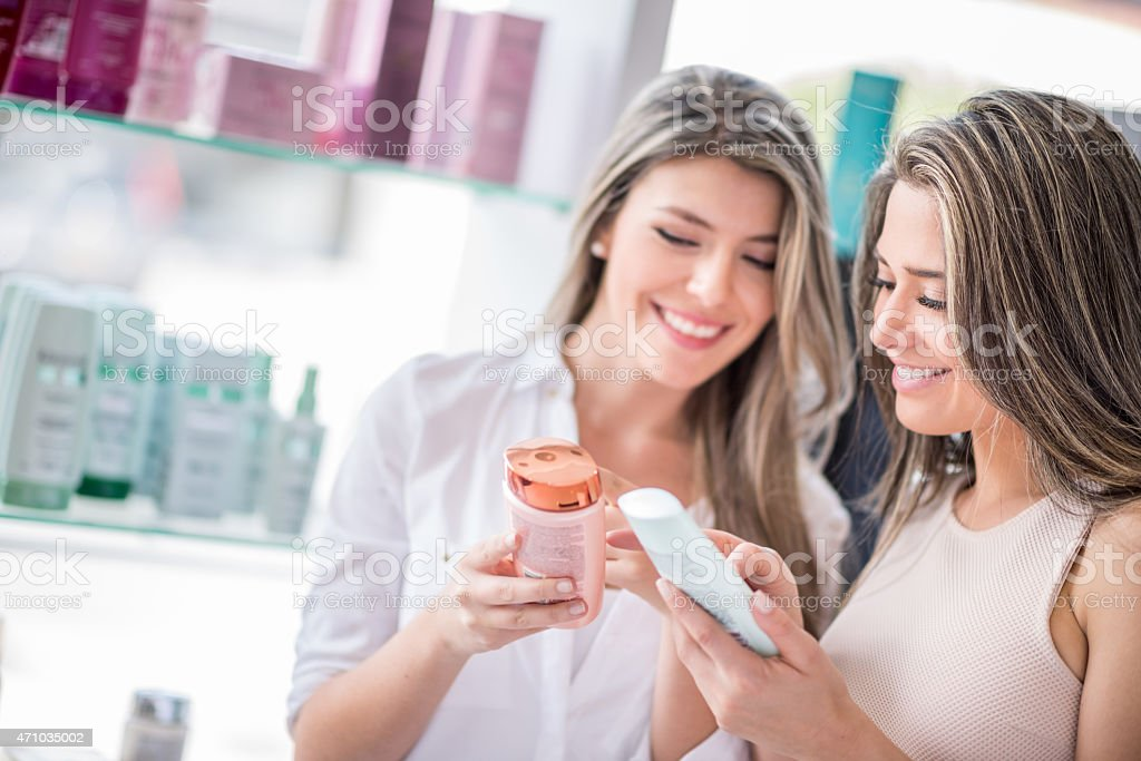 Women at a hair salon buying beauty products stock photo