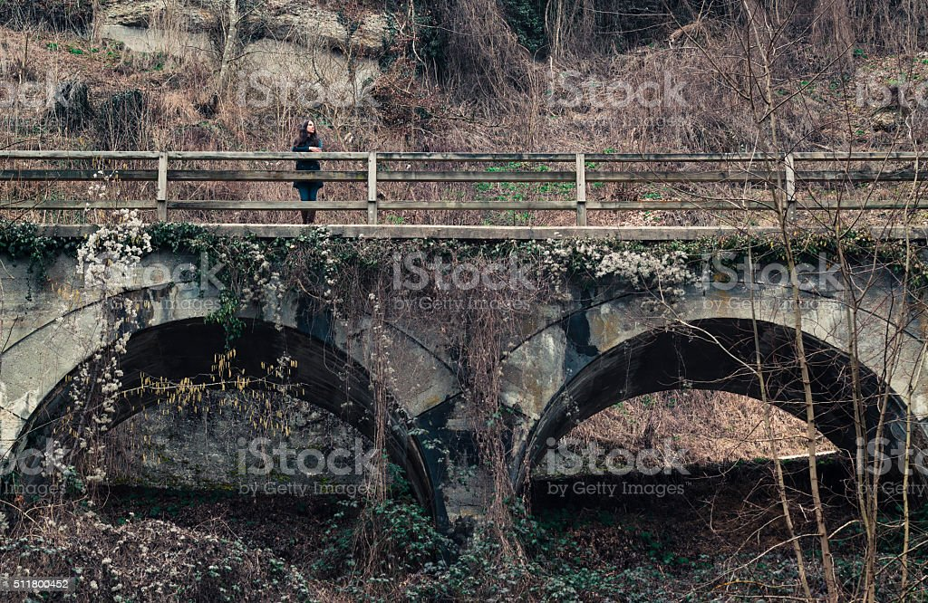 women at an old viaduct stock photo