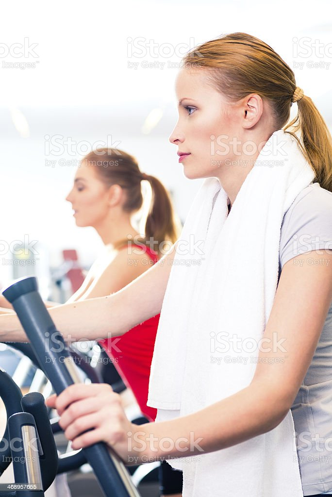 Women at cardio training in gym stock photo