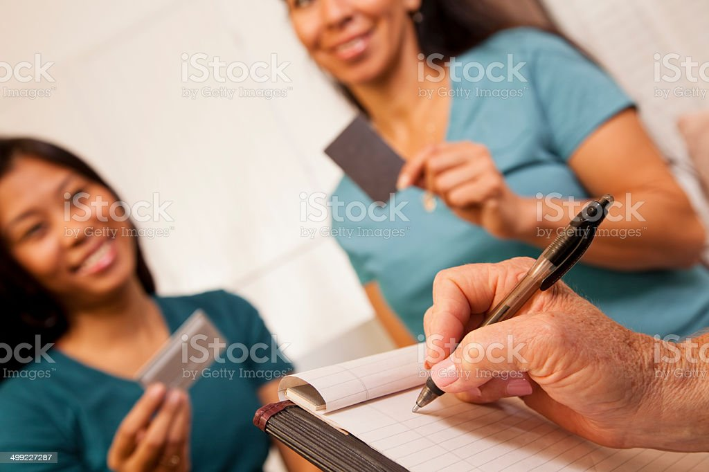 Women at counselor discuss credit card debt problems.  Therapy. stock photo