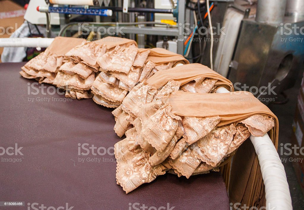 women at factory on production of panty hoses royalty-free stock photo