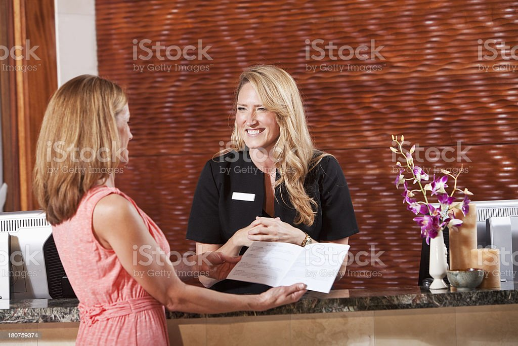 Women at hotel reception desk royalty-free stock photo