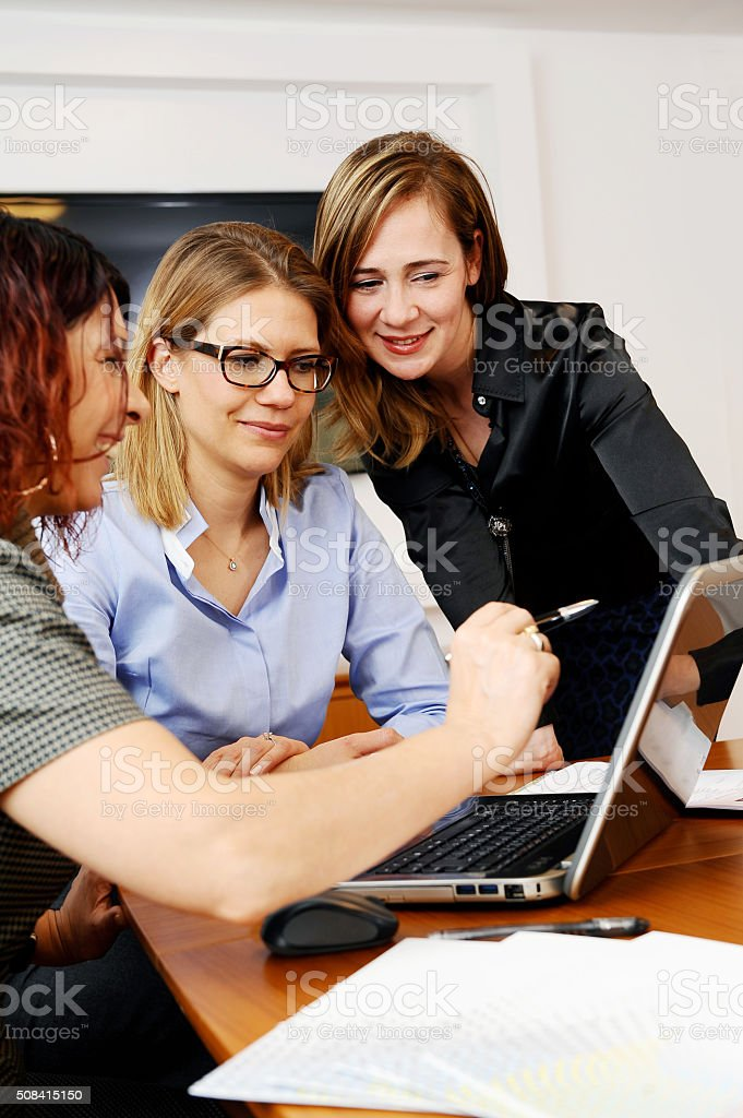 Women at meeting commenting datas stock photo