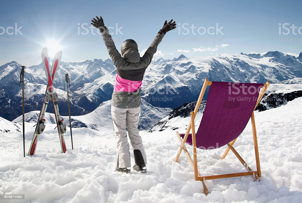 Women at mountains in winter with sun-lounger,France high mountains stock photo