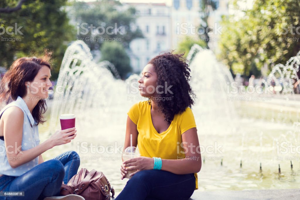 Women at the fountain drinking coffee stock photo
