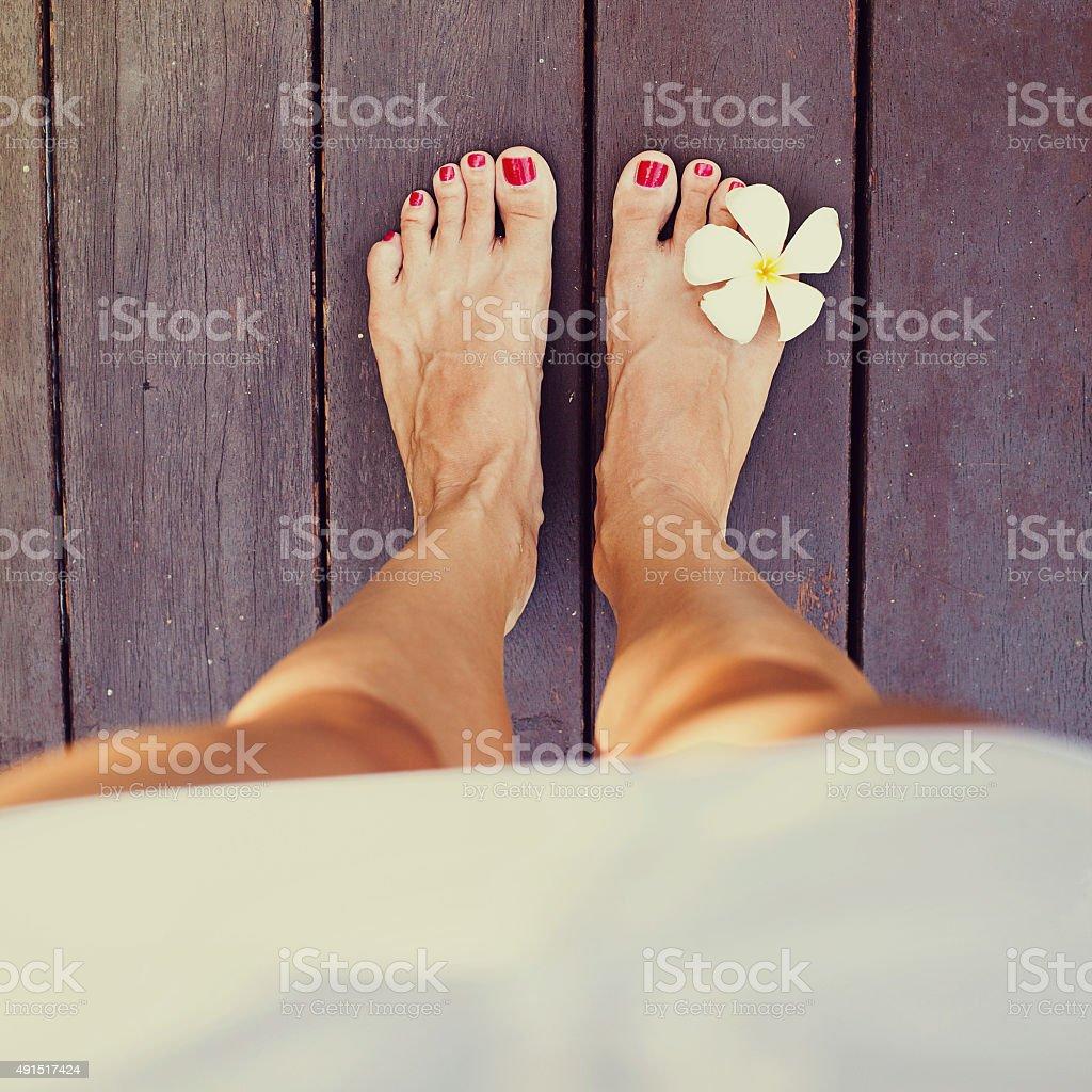 Women bare feet standing on a floor stock photo