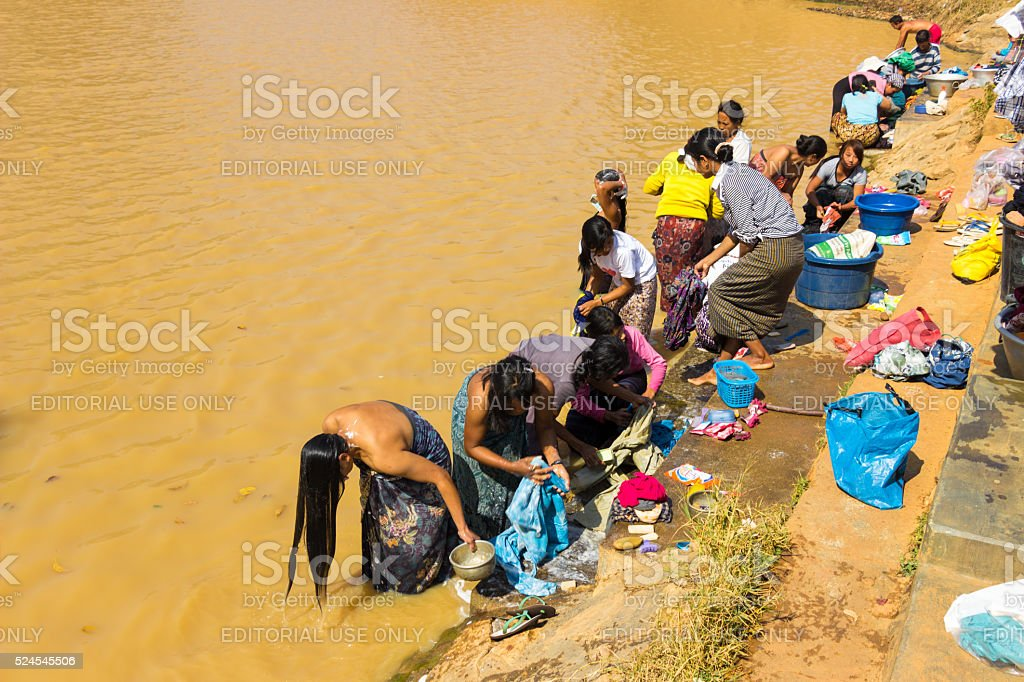 Women bathing in the river stock photo