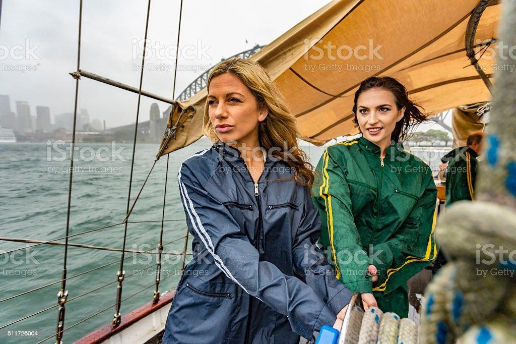 Women Battling a Storm on a Yacht in Sydney stock photo