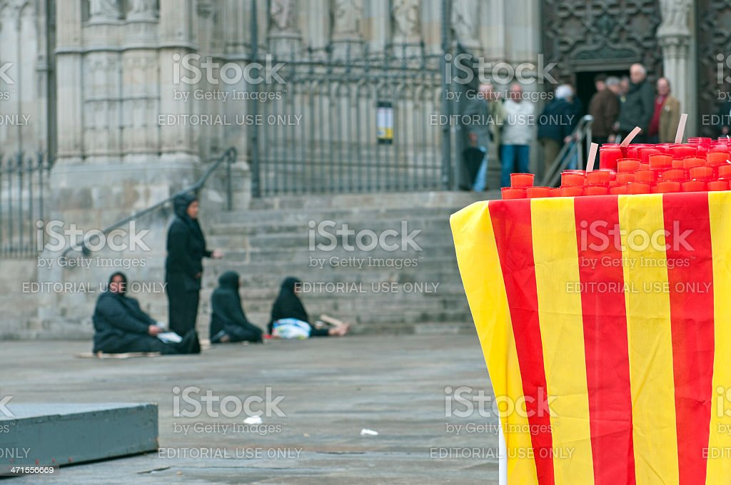 Women begging for alms on Good Friday in Barcelona royalty-free stock photo