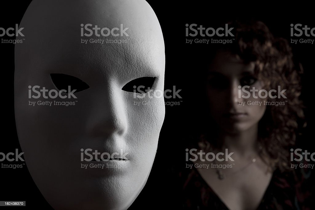 Women behind mask royalty-free stock photo