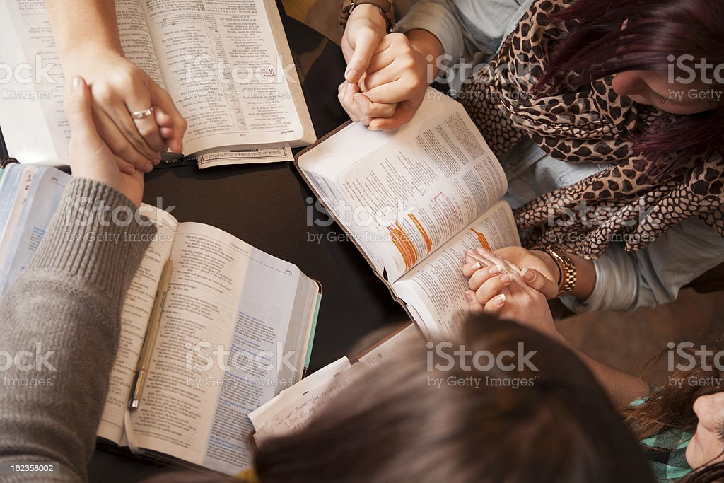 Women Bow And Pray stock photo