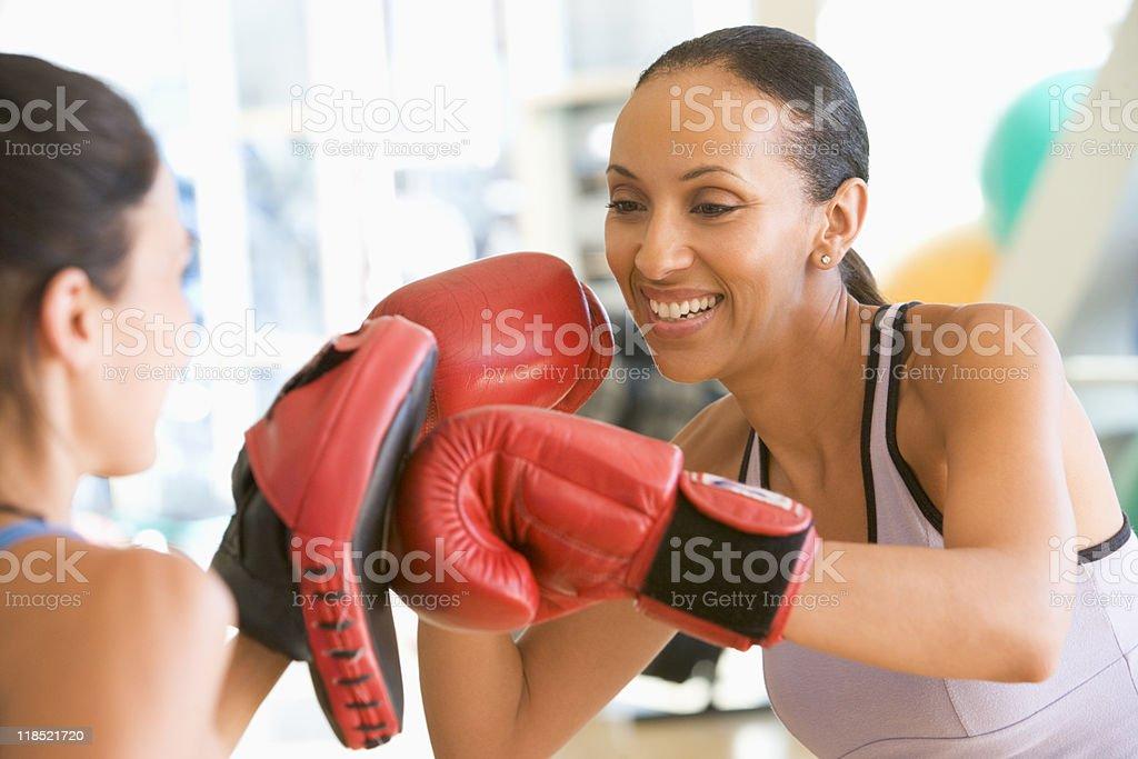 Women Boxing At Gym royalty-free stock photo