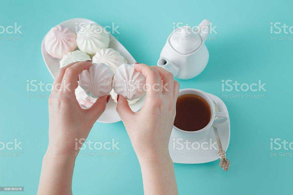 Women burst colored marshmallow for breakfast stock photo