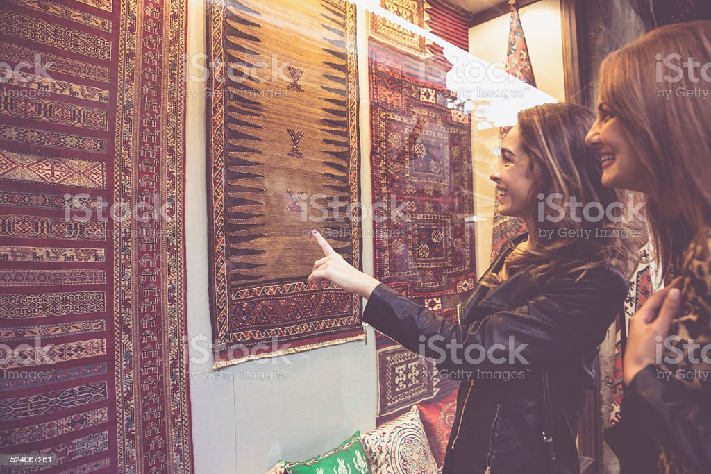 Women Buying Carpets stock photo